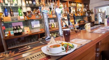 poolewe hotel bar-with-food-web
